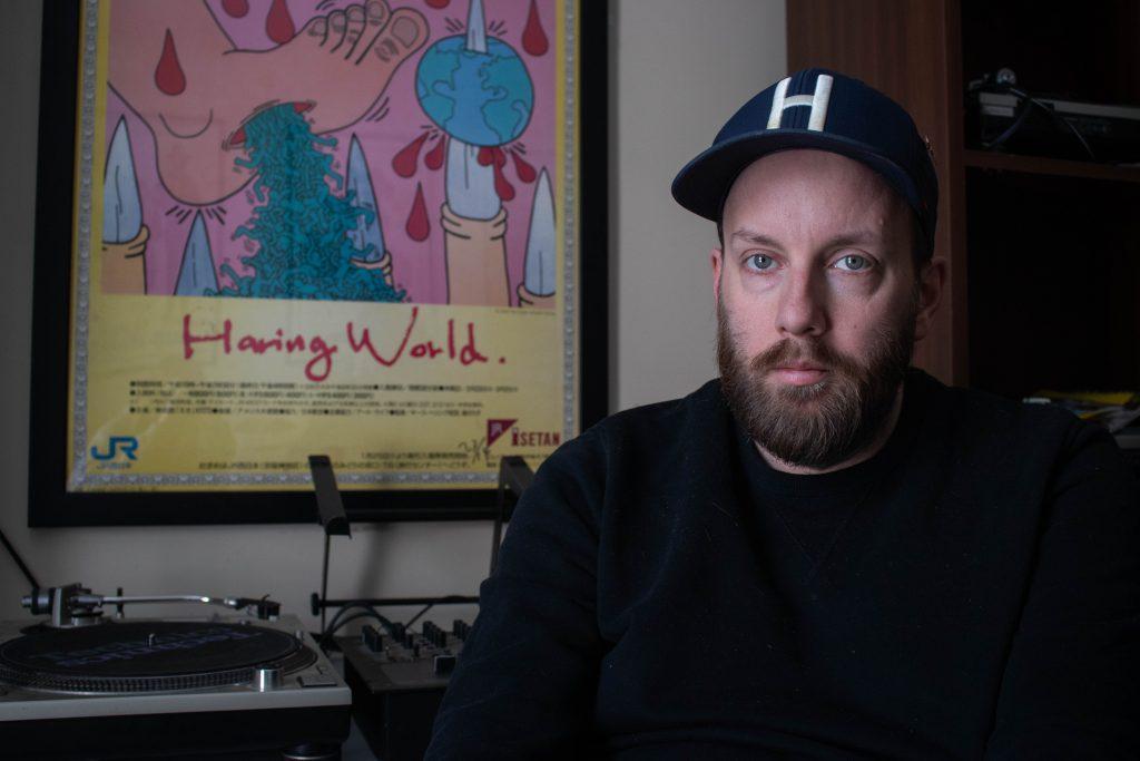 Tyler in his DJ equipment room.