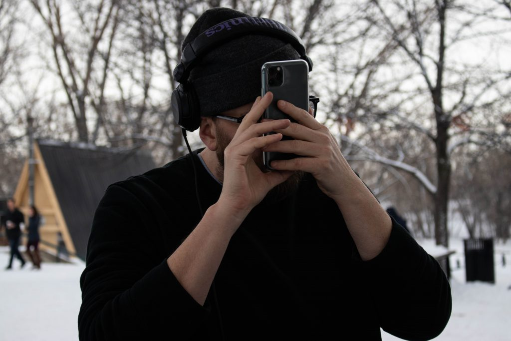 Tyler with his phone a centimetre away from his face to read it.