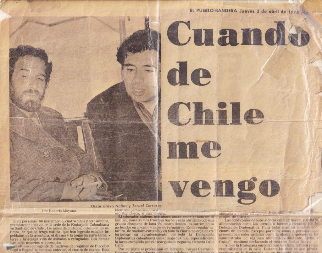 "A newspaper clipping shows two men  siting down. The headline says ""When from Chile I come"" in Spanish."
