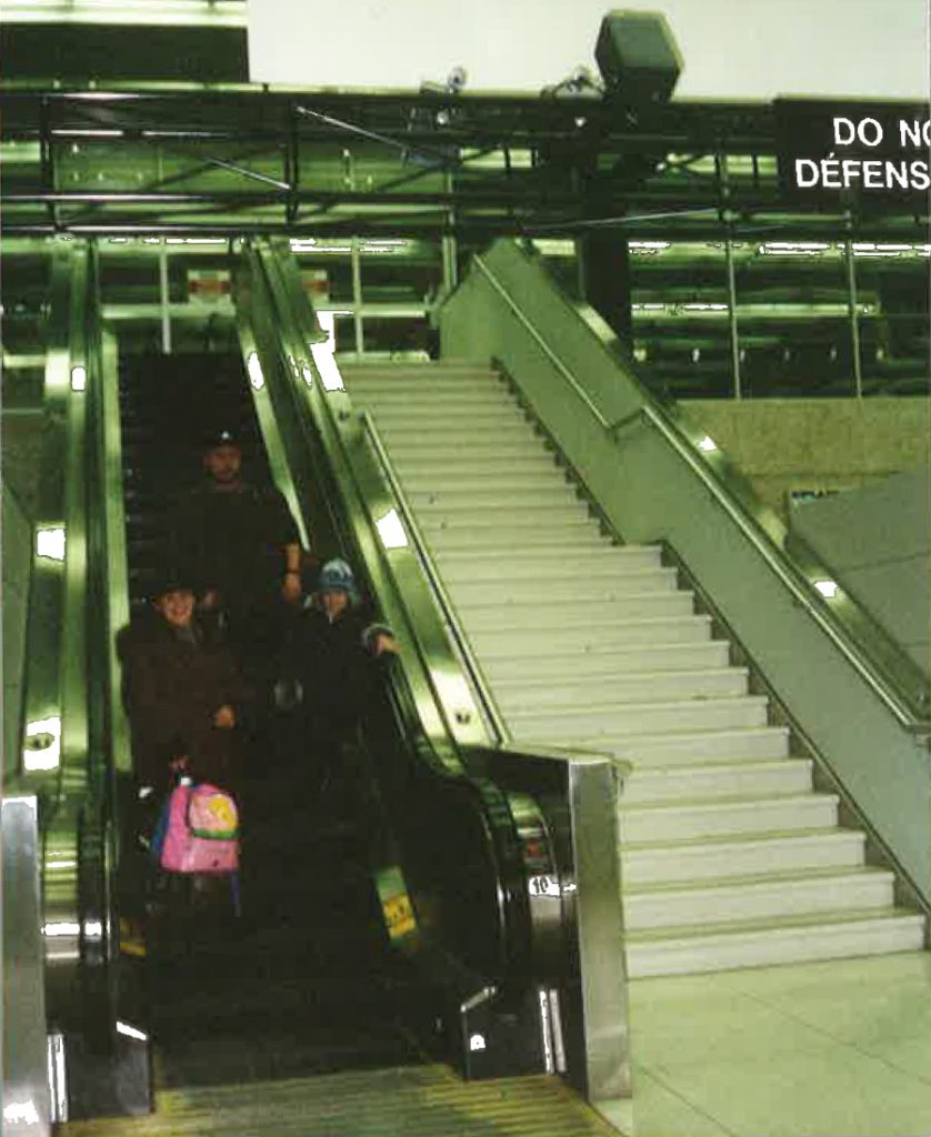 My parents and I on the airport escalator when we arrived in Winnipeg in 2002.