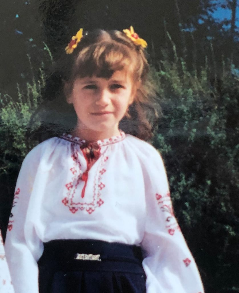 A photo of me at eight years old dressed in a traditional Ukrainian blouse after a recital.