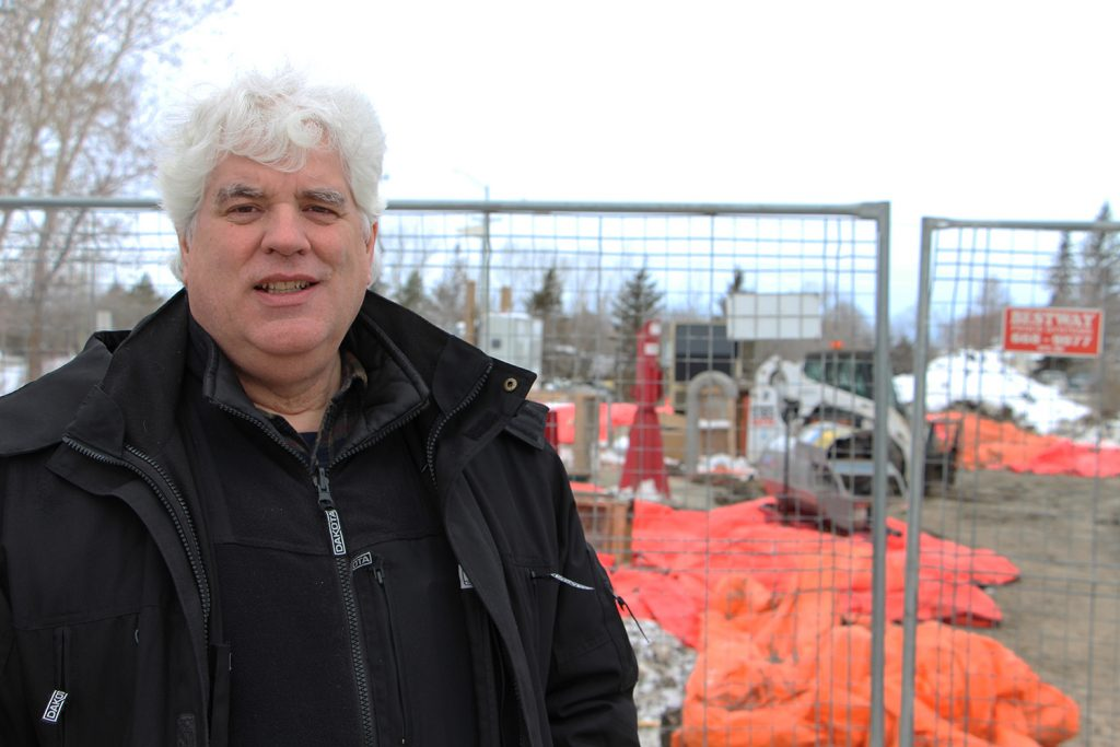 Glen McKenzie stands by the construction site of the future River Road lift station on Feb. 1.